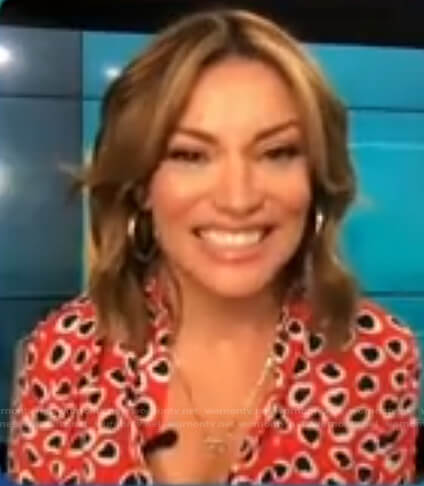 Kit's red heart print button down shirt on Access Hollywood