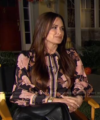 Kyle's black contrast floral blouse on E! News Daily Pop