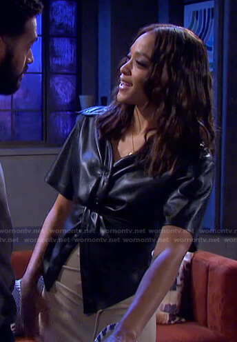 Lani's black leather shirt and beige slit skirt on Days of our Lives