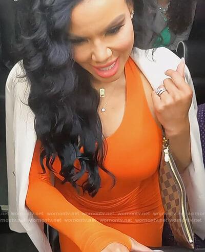 Mia's orange asymmetric neckline dress on The Real Housewives of Potomac