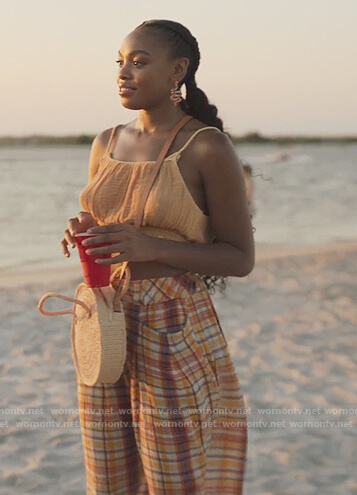 Angela's pink round straw bag on Our Kind of People