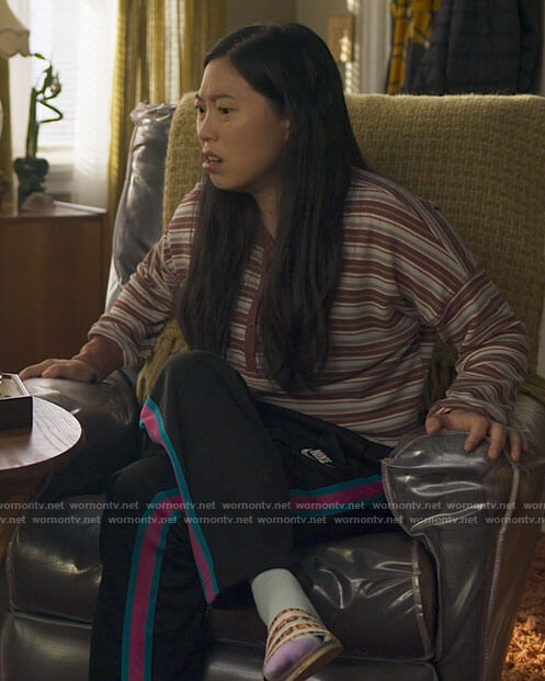 Nora's striped henley top and track pants on Awkwafina is Nora From Queens