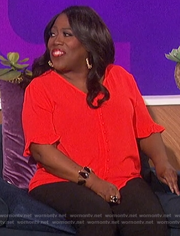 Sheryl's red button down blouse on The Talk