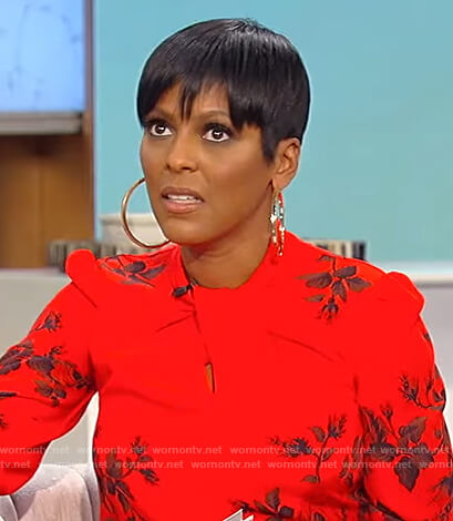 Tamron's red floral twist neck blouse on Tamron Hall Show