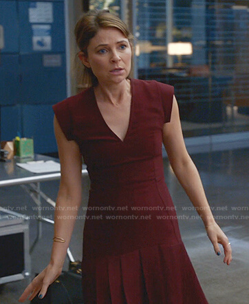 Taylor's burgundy pleated v-neck dress on Bull