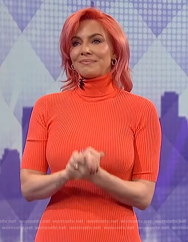 Whitney Cummings's coral ribbed asymmetric dress on The Wendy Williams Show