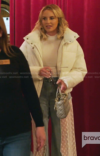 Whitney's white puff sleeve top and lace panel jeans on The Real Housewives of Salt Lake City